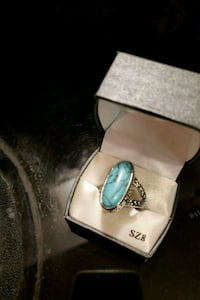 silver-colored ring with blue gemstone 2316 mi
