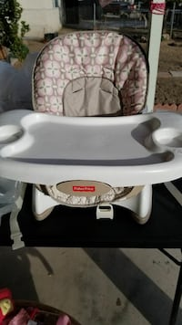 white and gray Fisher-Price high chair