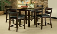 rectangular brown wooden table with four chairs di Plains, 31780