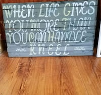 gray and white when life gives you more than you can handle kneel quote signage