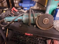 green and black corded angle grinder