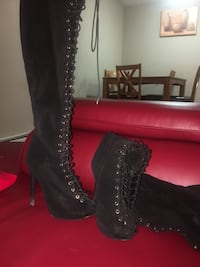 pair of black leather knee-high boots Calgary, T3B 0C9