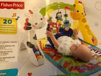 baby's white and multicolored Fisher-Price bouncer 3742 km