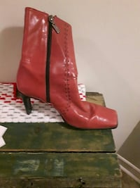 pair of red leather boots