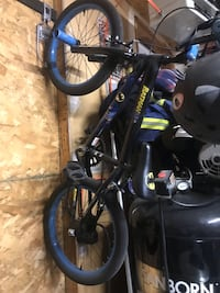 Black and blue hard tail mountain bike Beaumont, T4X 1C1