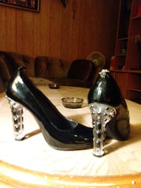 Pair of black leather peep-toe pumps Calgary, T3E 2L6