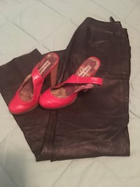 pair of red Steve Madden leather mules and black leather pants