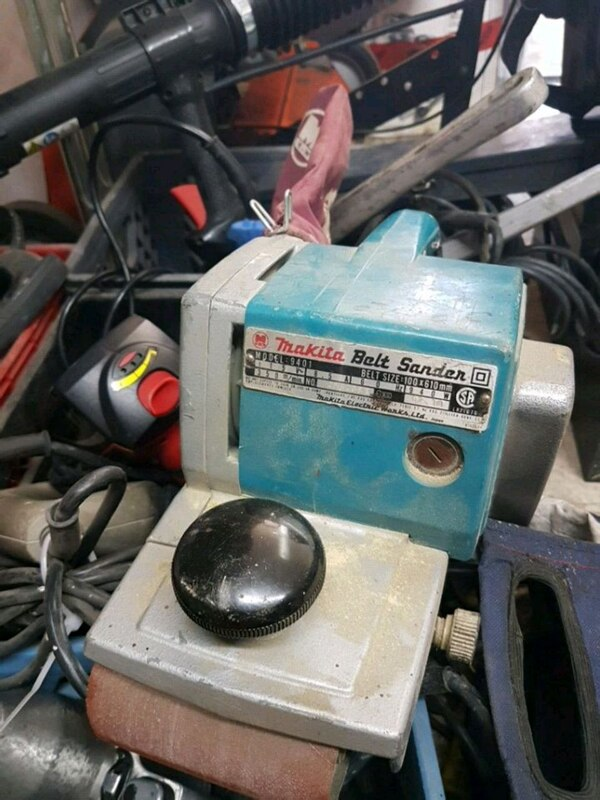 blue and black Makita corded power tool 9ee2cc91-0912-48c2-87d4-a3f55809bd41