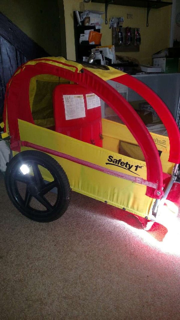 yellow and red safety 1st bike trailer