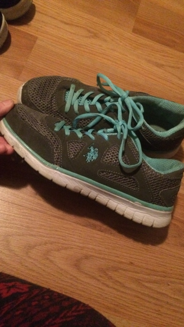 Grey and teal tennis shoes