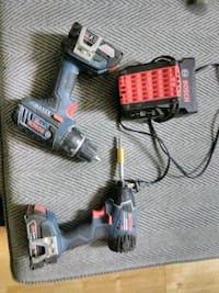 black and red Milwaukee cordless power drill