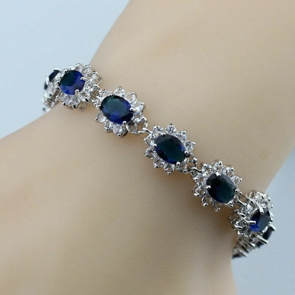 silver-colored bracelet with blue gemstones