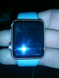 silver aluminum case Apple Watch with blue sports band Surrey, V3T 2K6