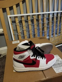pair of red-and-white Air Jordan 1 WASHINGTON