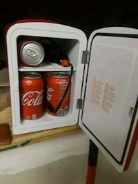 A travelingCoca-Cola mini refrigerator plus warmer New Caney, 77357