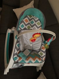 baby's white, gray, and green Fisher-Price rocker bouncer