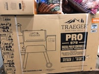 Brand New Traeger 575 Pro Grill & Smoker with Pellets, cover, and tray