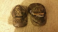 two brown-and-black camouflage Realtree fitted caps