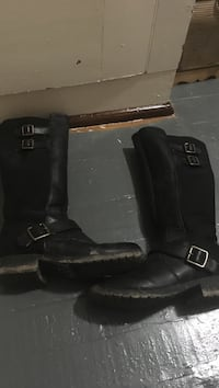 pair of black leather riding boots