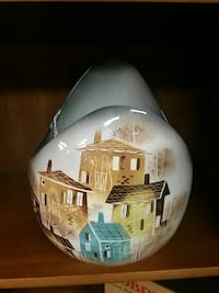 white, blue, and brown house printed ceramic vase