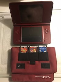Nintendo DSI XL Burgundy with 3 games. Kissimmee, 34758