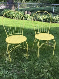 Pair of sunny yellow chairs. Grand Ledge, 48837