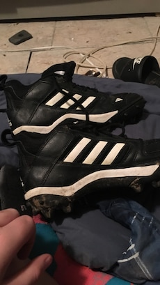 pair of black-and-white Adidas cleats