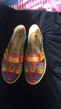 pair of yellow-and-pink low top sneakers Garden Grove, 92843