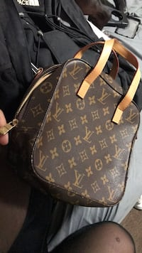brown Louis Vuitton leather handbag Manchester, 03104