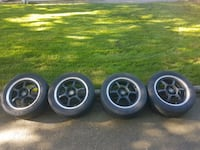 four black Traklite 5-spoke rims with tires Langley, V3A 5X4