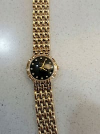 round gold analog watch with gold link bracelet Brampton, L6W 3E7