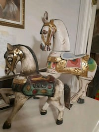 two white, brown, and green horse figurines
