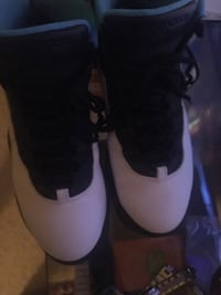 pair of white Air Jordan basketball shoes