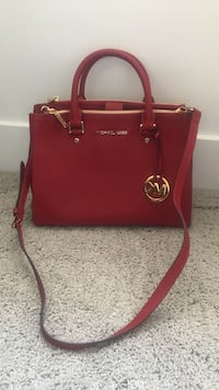 Mint condition fire engine red Michael Kors purse