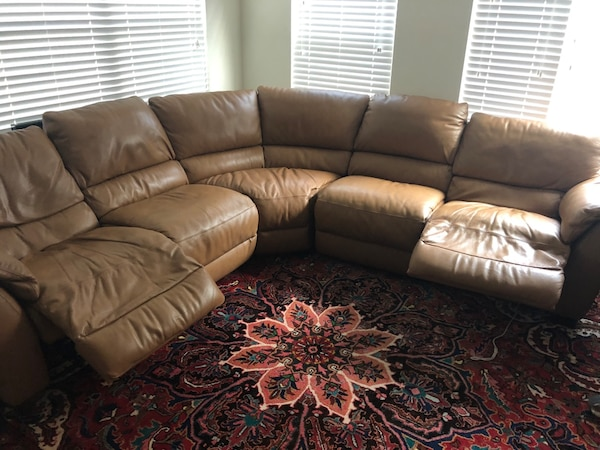 Brown leather sectional sofa with brook stone fleece matching pillows and 2  throw pillows