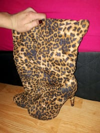 brown and black leopard print textile 3153 km