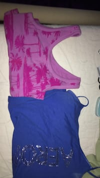 two women's blue and pink sleeveless shirts