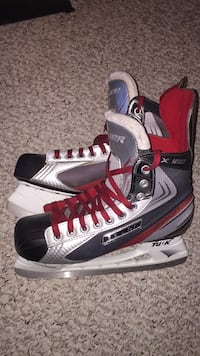 Pair of gray-and-black bauer ice skates