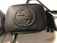 women's black leather Gucci sling bag