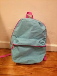 teal and pink fabric backpack.