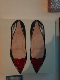 Sign of Pair of red pointed-toe flats Centreville, 20120