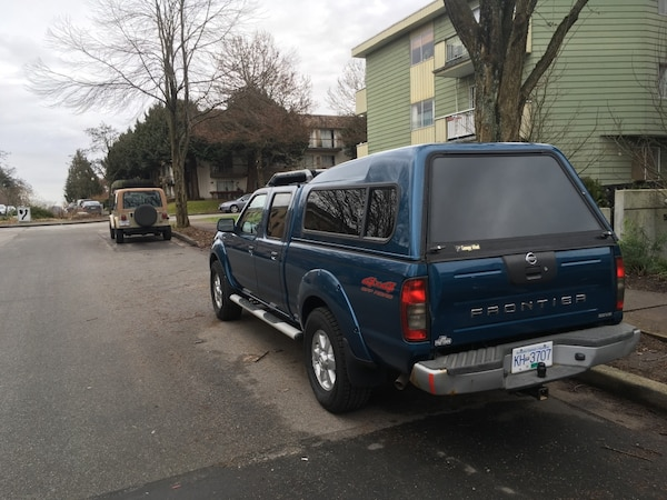 Nissan Frontier Camper Shell >> Blue Nissan Frontier With Camper Shell
