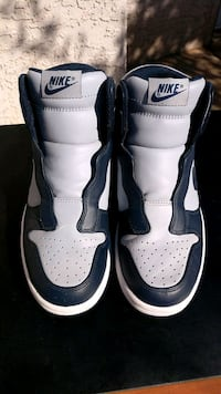 pair of white-and-black Nike sneakers Avondale