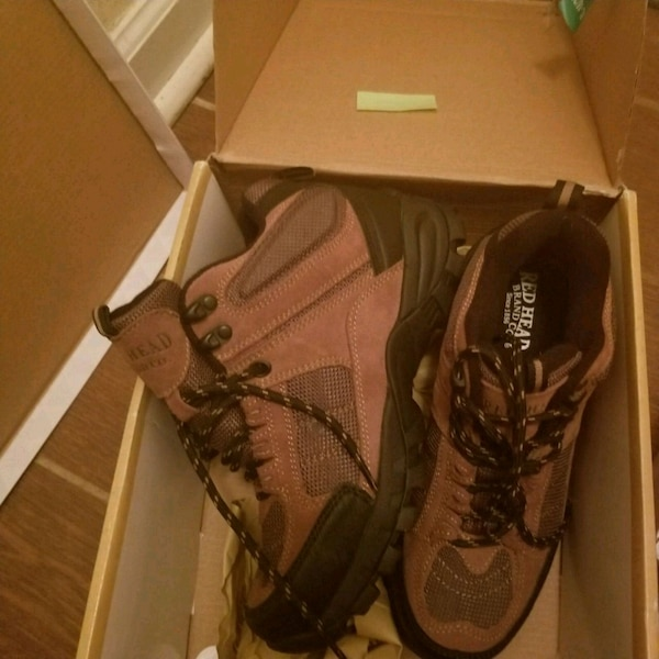 pair of brown-and-black Nike basketball shoes