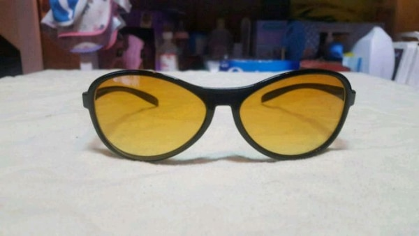 black framed yellow lens sunglasses