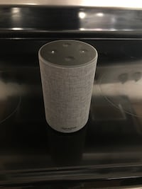 white and gray portable speaker 748 mi