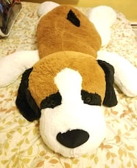 brown and white dog plush toy
