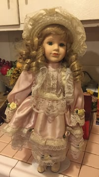 Blonde haired porcelain doll in pink and white satin and lace long sleeve dress Carson, 90745