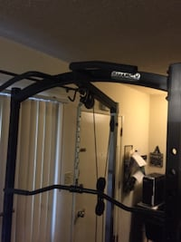 black and gray Marcy exercise machine BELL