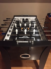 black and gray foosball table